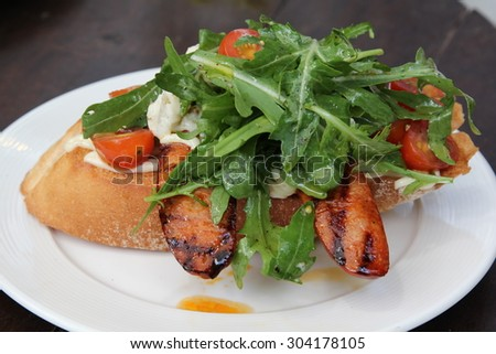 Healthy italian sandwich on white plate.
