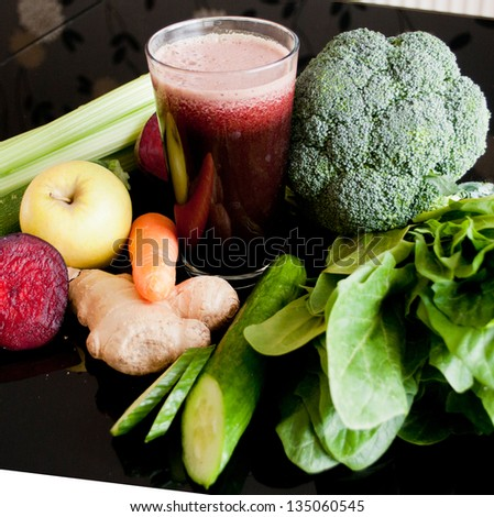 healthy juice made of organic fresh fruits and vegetables - stock photo