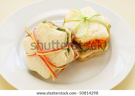 Healthy kids sandwiches cut in the shape of a star and tied up. - stock photo