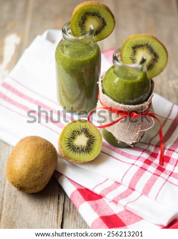 Healthy kiwi smoothie in a glass. Selective focus
