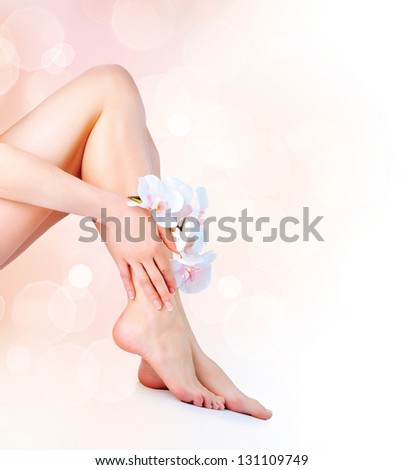 Healthy Legs. Spa. Beautiful woman Legs and Hands isolated on white. Depilation. Epilation - stock photo