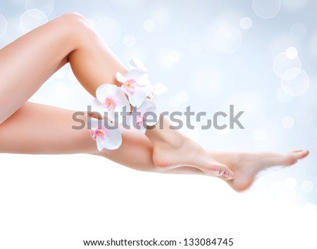 Healthy Legs. Spa. Long woman legs isolated on white. Skincare. Depilation. Epilation - stock photo