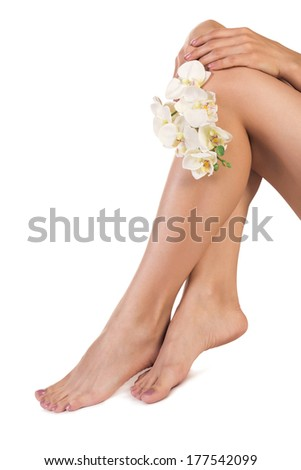 Healthy Legs. Spa. Skincare. Long woman legs and Hands isolated on white - stock photo