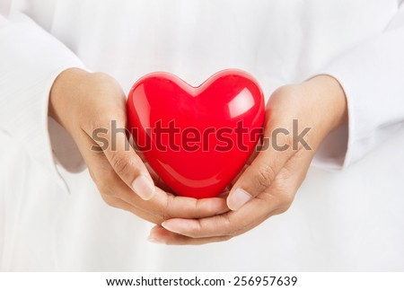 Healthy life and valentine's day - person holding a heart symbol - stock photo