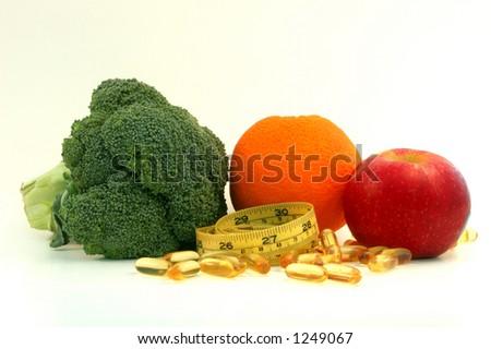Healthy Life. Broccoli,orange,apple,fish oil,measure tape - stock photo