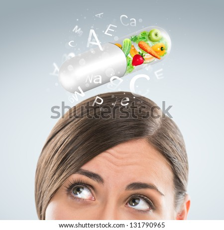 Healthy life concept. Woman with vitamins overhead - stock photo
