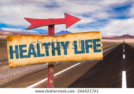 Healthy Life sign with road background - stock photo