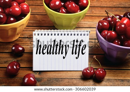 Healthy life word on notepad - stock photo