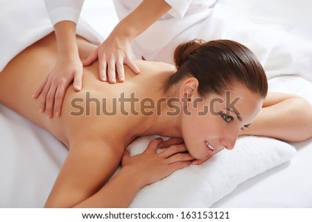 Healthy life. Young beautiful woman relaxed in spa environment - stock photo