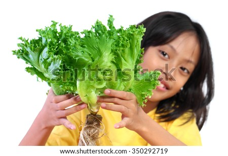Healthy lifestyle - Asian girl holding green salad isolated on white background .