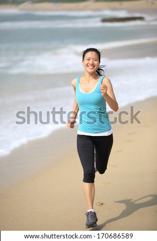 healthy lifestyle beautiful asian woman running at beach