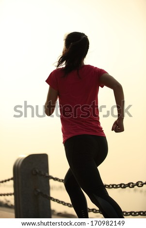 healthy lifestyle beautiful asian woman running at seaside