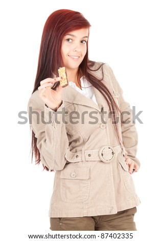 healthy lifestyle, beautiful teenage girl eating bar with cereals, white background - stock photo