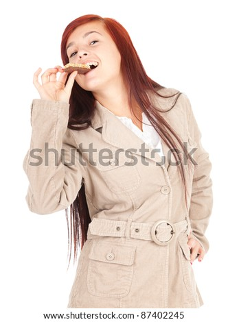 healthy lifestyle, beautiful young woman eating granola bar, white background - stock photo