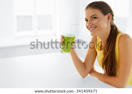 Healthy Lifestyle. Closeup Of Beautiful Smiling Woman Drinking Green Detox Vegetable Juice. Healthy Diet And Eating. Vegetarian Food. Drink Smoothie. Health Care And Beauty Concept. - stock photo