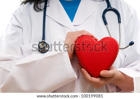 Healthy lifestyle concept - Female doctor with red heart on her hand isolated over white background - stock photo
