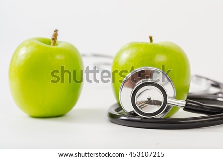 Healthy Lifestyle Concept ,Medical stethoscope for healthy and apple for diet - stock photo