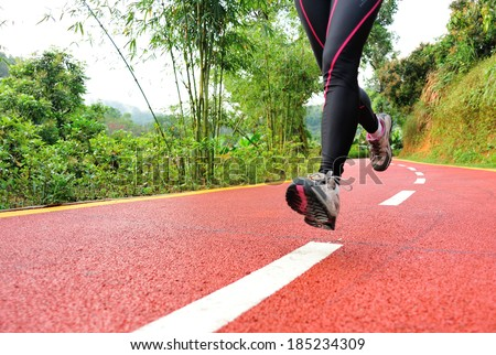 healthy lifestyle fitness sports woman legs running at park trail - stock photo