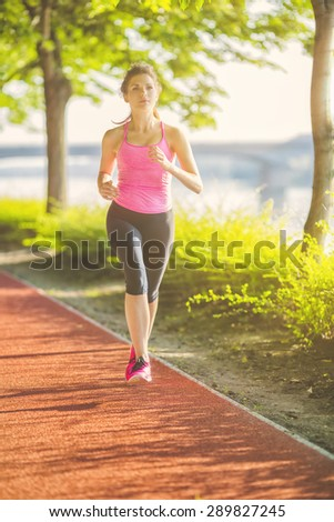 healthy lifestyle fitness sports woman running at park trail