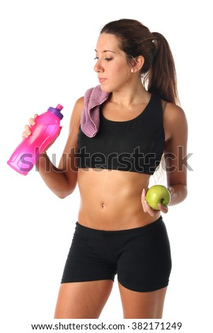 Healthy lifestyle. Fitness woman drinking water isolated - stock photo