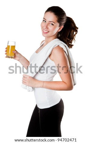 Healthy lifestyle - fitness woman with towel and juice smiling happy looking at camera. Pretty woman isolated on white background. - stock photo