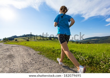 Healthy lifestyle - girl running, jumping  - stock photo