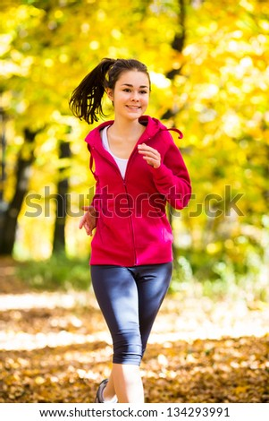Healthy lifestyle - girl running, jumping outdoor