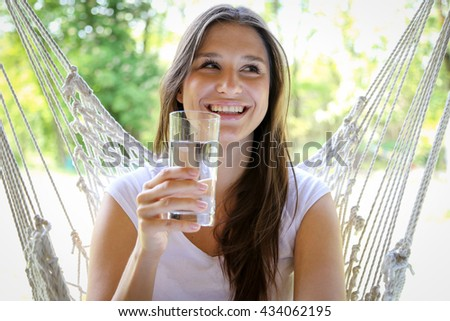 Healthy Lifestyle. Happy, beautiful  woman with glass of fresh water.