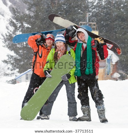 Healthy lifestyle image of happy snowboarders team, Snowfall - stock photo