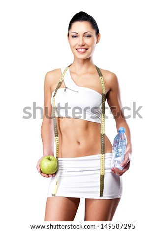 Healthy lifestyle of a happy woman with slim body after diet. Sporty female with perfect figure - stock photo