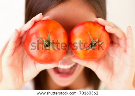Healthy lifestyle people. Funny image of woman showing tomatoes. - stock photo