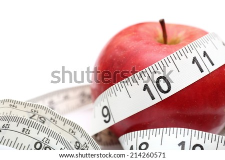 Healthy Lifestyle. Red apple and tape measure on white background. Closeup. - stock photo