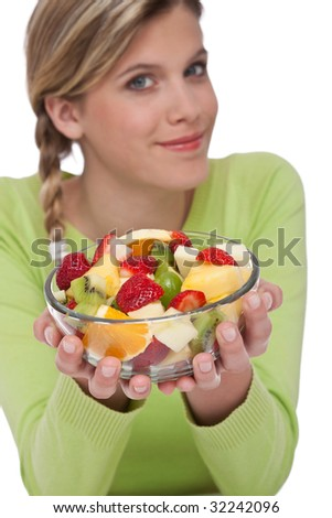 Healthy lifestyle series - Woman holding fruit salad on white background, focus on bowl