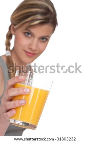 Healthy lifestyle series - Woman with glass of orange juice on white background, focus on hand