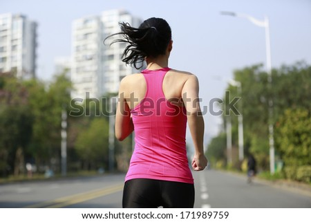 healthy lifestyle sports woman running on asphalt driveway  - stock photo
