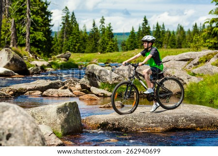 Healthy lifestyle - teenage boy biking - stock photo