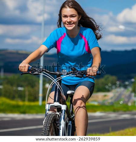 Healthy lifestyle - teenage girl biking - stock photo