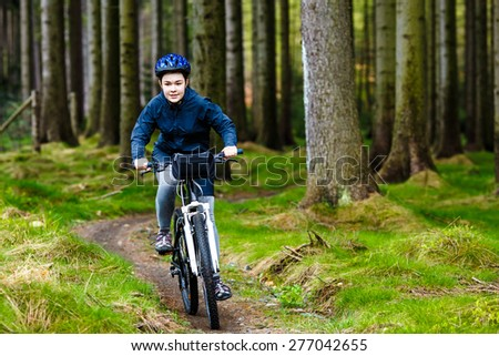 Healthy lifestyle - teenage girl biking - stock photo
