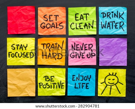 healthy lifestyle tips (eating, fitness, mindset, determination, positivity) - handwriting on a set of colorful sticky notes - stock photo