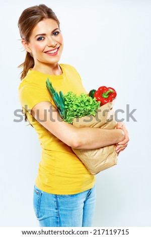 Healthy lifestyle with green vegan food. Young woman green diet concept. White background.