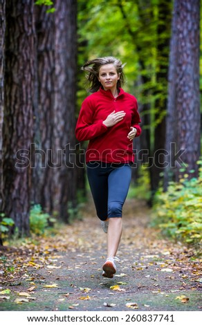 Healthy lifestyle - woman running in park - stock photo
