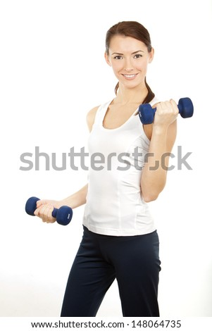 Healthy lifestyle. Young brunette woman with dumbells