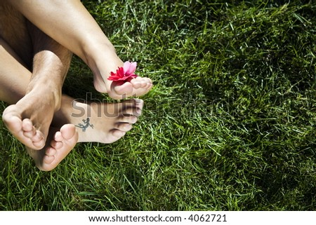 Healthy lifestyle: young couple laying down on the grass - stock photo