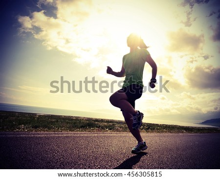 healthy lifestyle young fitness woman runner running on sunrise road