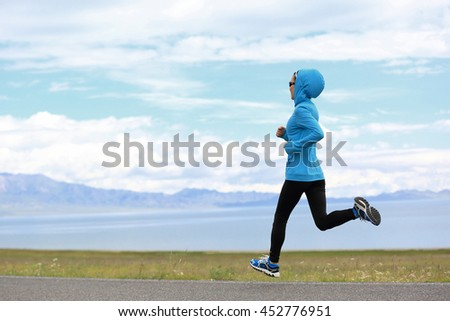 healthy lifestyle young woman runner running on seaside trail