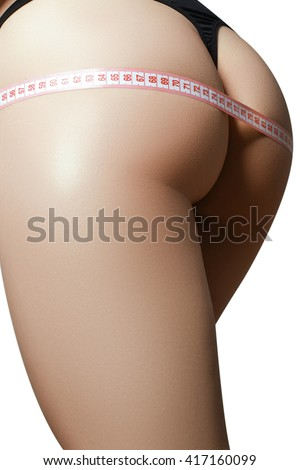 Healthy lifestyles concept. Woman body part is being measured. Spa beauty part of body. Healthy lifestyle diet and fitness Perfect waist, butt and legs - stock photo
