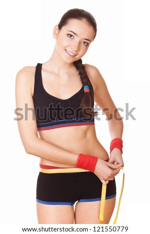 healthy lifestyles concept: woman measuring perfect shape of beautiful hips - stock photo