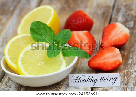Healthy living card with lemon and strawberries  - stock photo