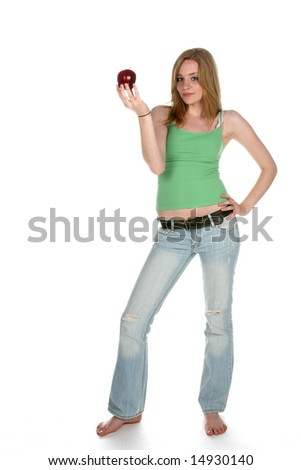 healthy looking woman in green holding a red apple - stock photo