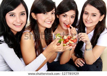 healthy lovely group of woman having fresh salad together